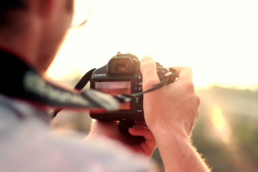 man-camera-taking-photo-photographer